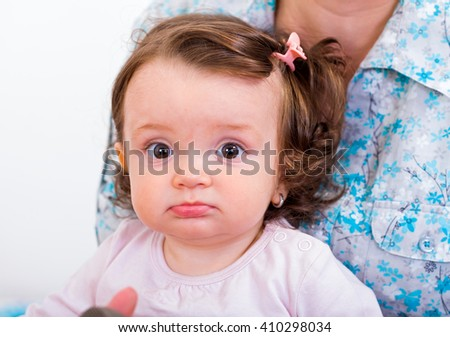 Portrait of an adorable baby looking at the camera - stock photo