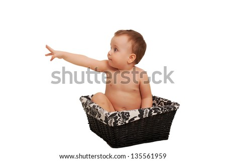 Portrait of an adorable baby sitting in a basket isolated on white background