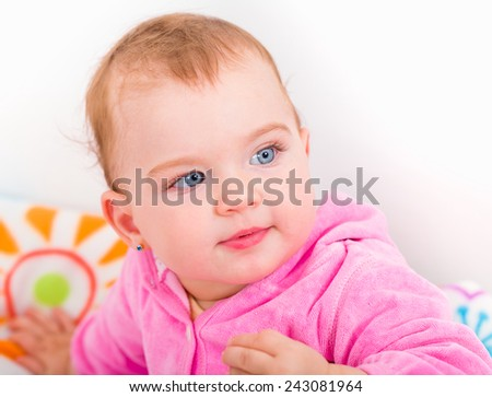 Portrait of an adorable blue eyed baby - stock photo