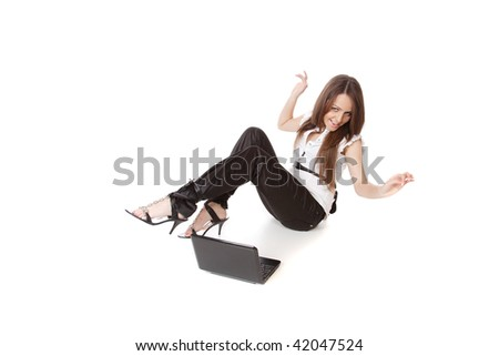 Portrait of an adorable casual woman with a laptop, working on the floor.