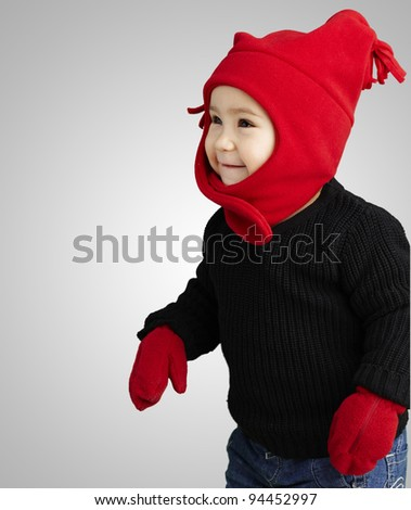portrait of an adorable kid smiling wearing winter clothes over - stock photo