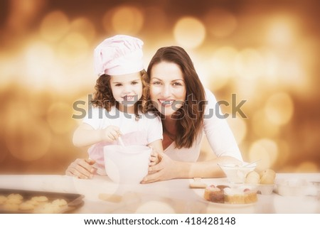 Portrait of an adorable mother and daughter preparing a daugh together against glowing background - stock photo