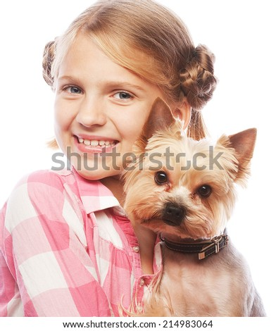Portrait of an adorable young girl smiling holding Yorkshire Terrier puppy  - stock photo