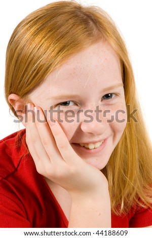 portrait of an adorable young girl with her hand on cheek on white background