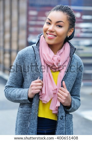 Portrait of an adorable young mixed race woman having fun outdoors in her trendy outfit - stock photo