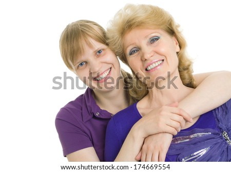 Portrait of an adult daughter and elderly mother - stock photo
