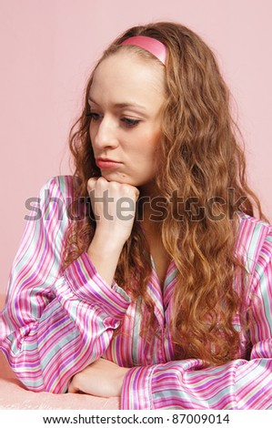 portrait of an adult girl on pink background