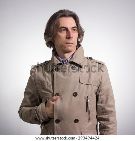 Portrait of an adult man in a gray jacket. - stock photo