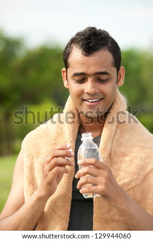 Portrait of an adult with a bottle after training - stock photo