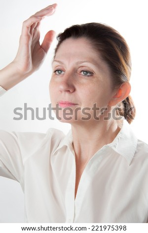 Portrait of an adult woman with raised hand. Natural beauty. Closeup. - stock photo