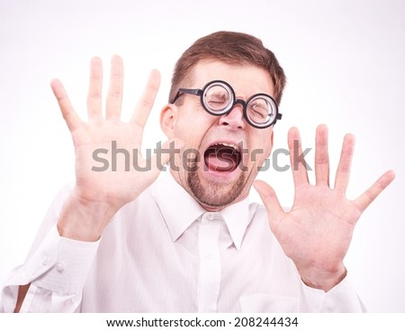 Portrait of an afraid man in glasses - stock photo