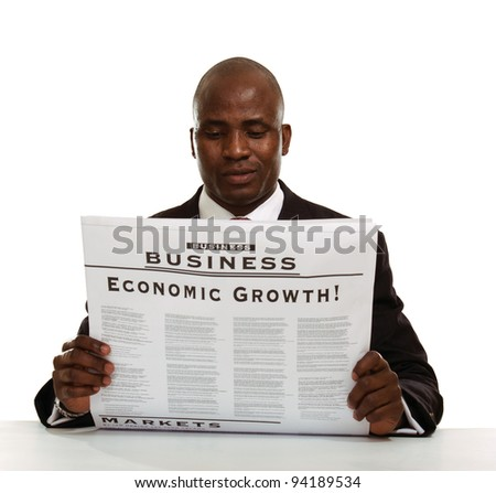 Portrait of an African American businessman reading a newspaper, isolated on white background - stock photo
