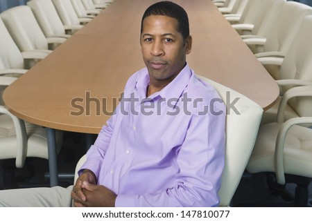 Portrait of an African American businessman sitting in the conference room