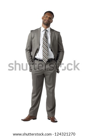 Portrait of an African-American businessman wearing gray business suit smiling over the white surface - stock photo