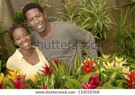 Portrait of an African American couple smiling at botanical garden - stock photo