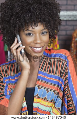 Portrait of an African American female fashion designer on phone call - stock photo