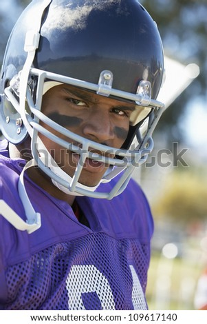 Portrait of an African American football player wearing headgear - stock photo