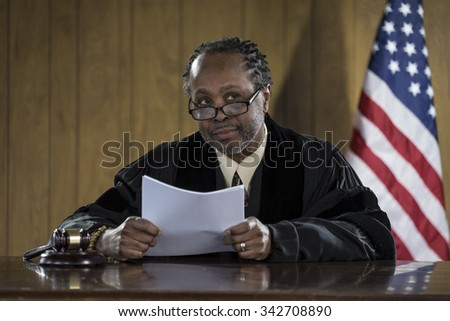Portrait of an African American judge in a courtroom