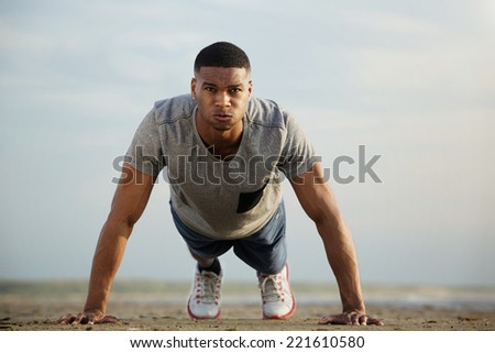 Portrait of an african american man exercising outdoors  - stock photo