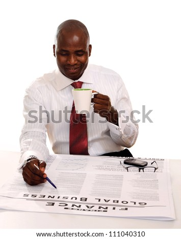 Portrait of an African American with cup of tea or coffee and newspaper - stock photo