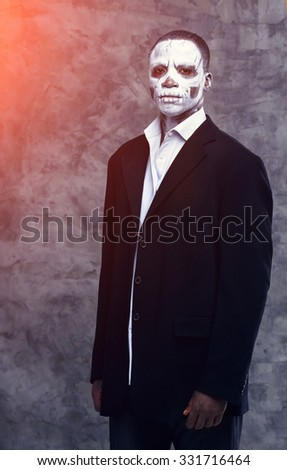 Portrait of an african businessman in the image of a skeleton or zombie. Festival, carnival, party, Halloween male african zombies. African people. Voodoo people. Business man in the form of a zombie. - stock photo