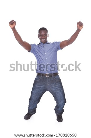 Portrait Of An African Excited Young Man On White Background - stock photo