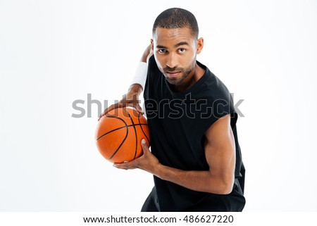 Portrait of an african man playing basketball isolated on a white background
