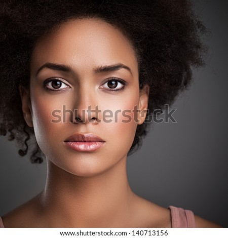Portrait of an African woman with a serious expression on her face.