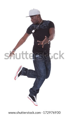 Portrait Of An African Young Man Dancing Over White Background - stock photo