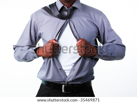 Portrait of an Afro-American businessman showing tshirt under his suit isolated against white - stock photo