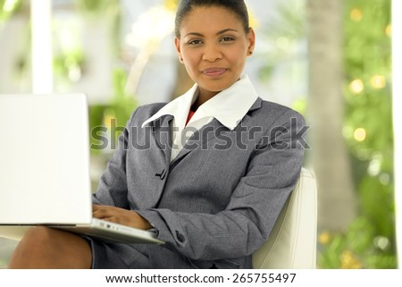 Portrait of an Afro American Businesswoman with laptop on knees