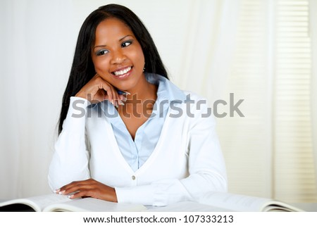 Portrait of an afro-american young black girl studying at soft colors composition