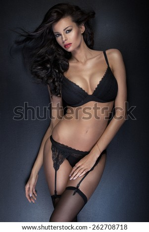 Portrait of an alluring brunette woman - stock photo