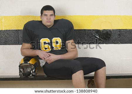 Portrait of an American football player - stock photo