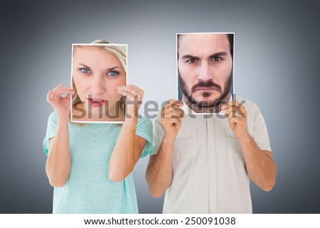 Portrait of an angry businessman against grey vignette - stock photo