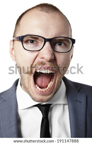 Portrait of an angry businessman. Facial expression.