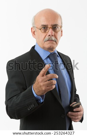 portrait of an angry businessman talking to you and pointing hand at you