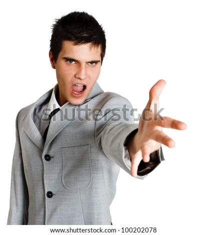 Portrait of an angry businessman yelling at someone - stock photo