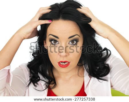 Portrait of an Angry Frustrated Young Hispanic Woman Pulling Her Hair Looking Into Camera - stock photo