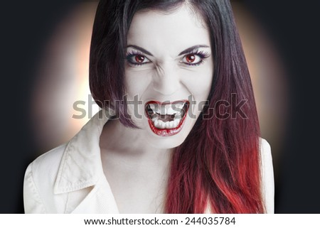 Portrait of an angry Lady Vampire. - stock photo