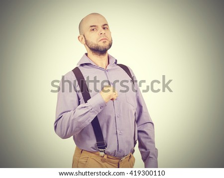 Portrait of an angry, proud man shows itself. - stock photo