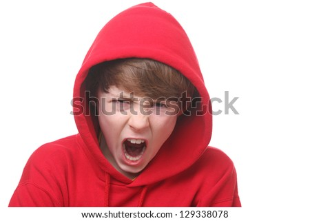 Portrait of an angry young boy on white background - stock photo