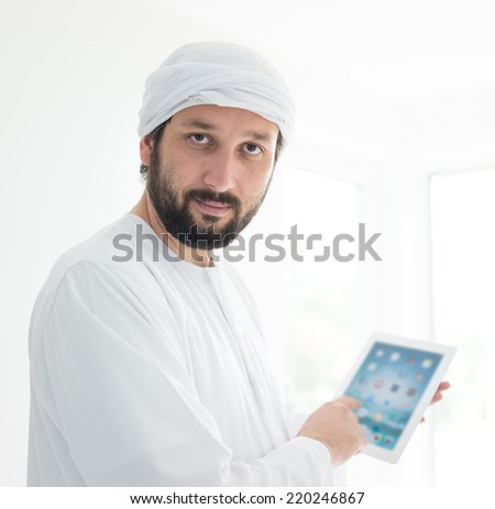 Portrait of an Arabian man with tablet
