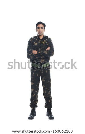 Portrait of an army soldier standing with his arms crossed - stock photo