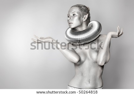 Portrait of an artistic woman painted in metal style. Shot in a studio. - stock photo