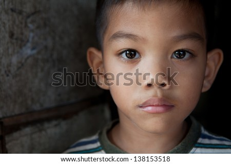 Portrait of an Asian boy from impoverished area in the Philippines - stock photo