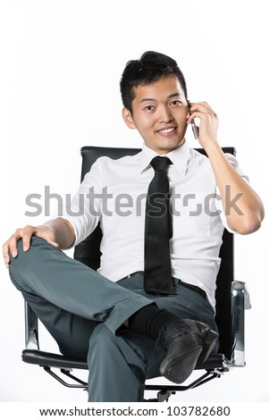 Portrait of an Asian business man using a cell phone - stock photo
