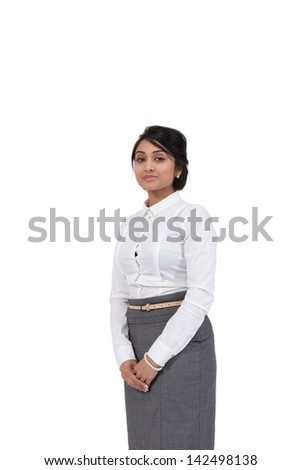 Portrait of an Asian businesswoman standing against white background - stock photo