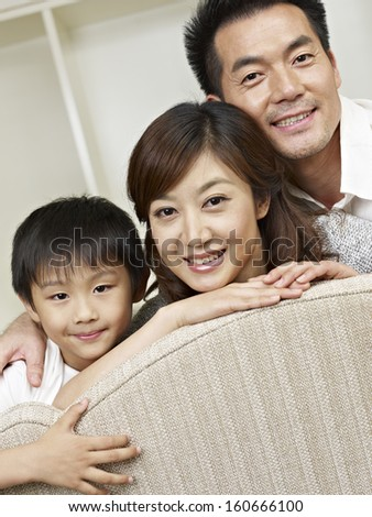 portrait of an asian family of three. - stock photo