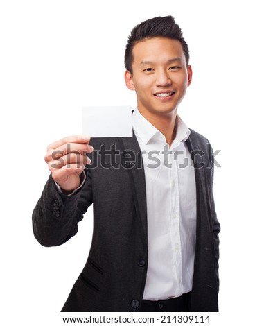 portrait of an asian man holding a white card - stock photo